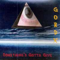 [Gord-X Something's Gotta Give Album Cover]